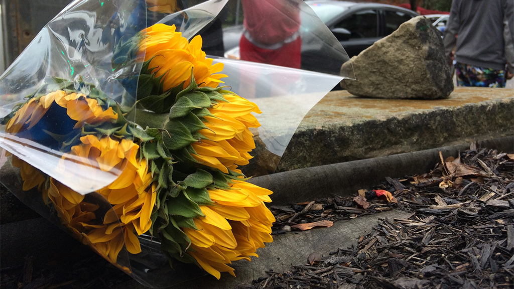 Flowers lying on a sidewalk outside of Pittsburgh synagogue